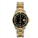 Pre-Owned Rolex Oyster Black & Gold GMT